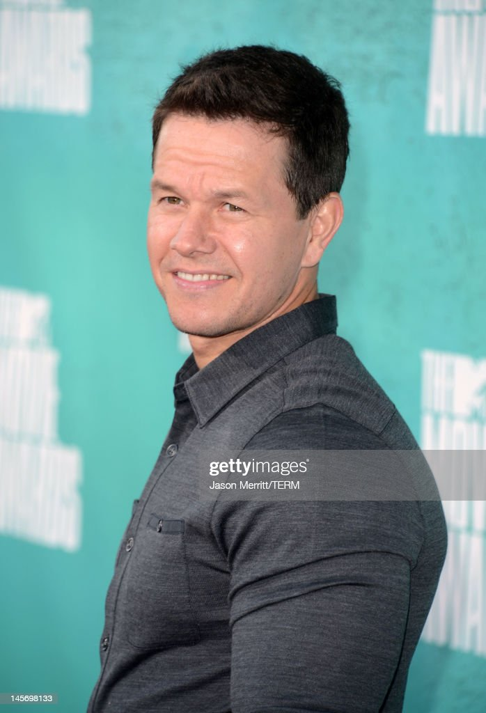 Actor <a gi-track='captionPersonalityLinkClicked' href=/galleries/search?phrase=Mark+Wahlberg&family=editorial&specificpeople=202265 ng-click='$event.stopPropagation()'>Mark Wahlberg</a> arrives at the 2012 MTV Movie Awards held at Gibson Amphitheatre on June 3, 2012 in Universal City, California.