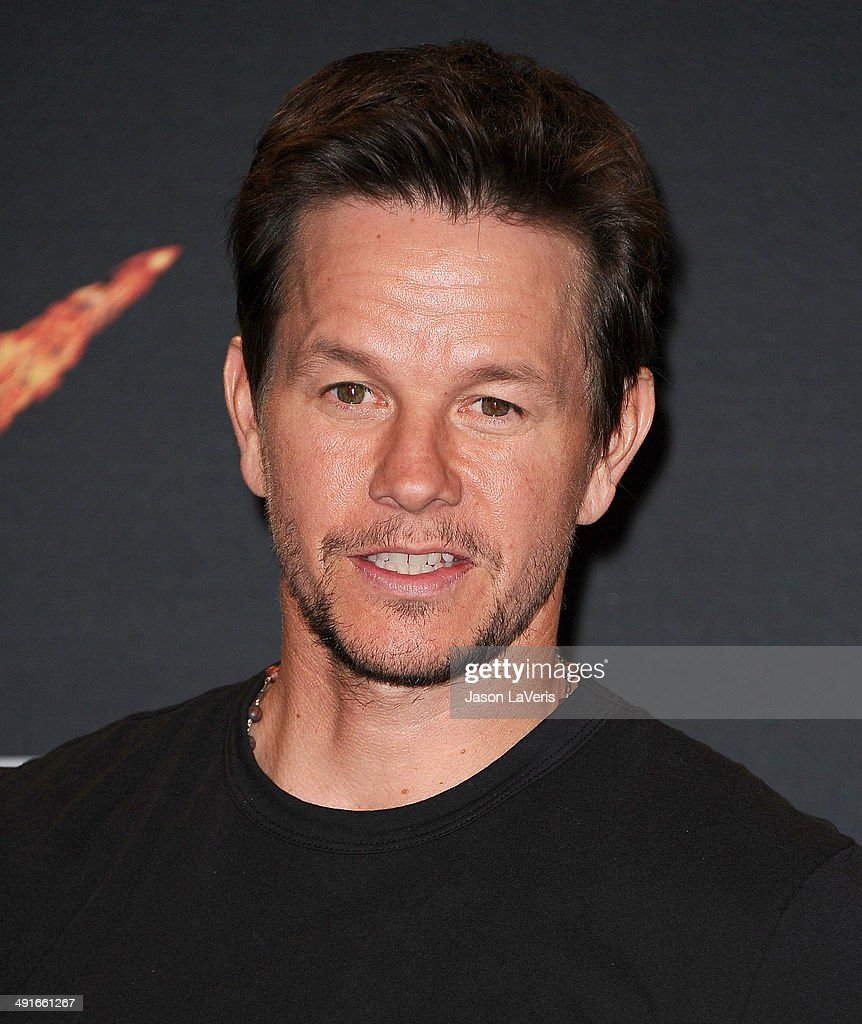 Actor Mark Wahlberg poses in the press room at the 2014 MTV Movie Awards at Nokia Theatre L.A. Live on April 13, 2014 in Los Angeles, California.