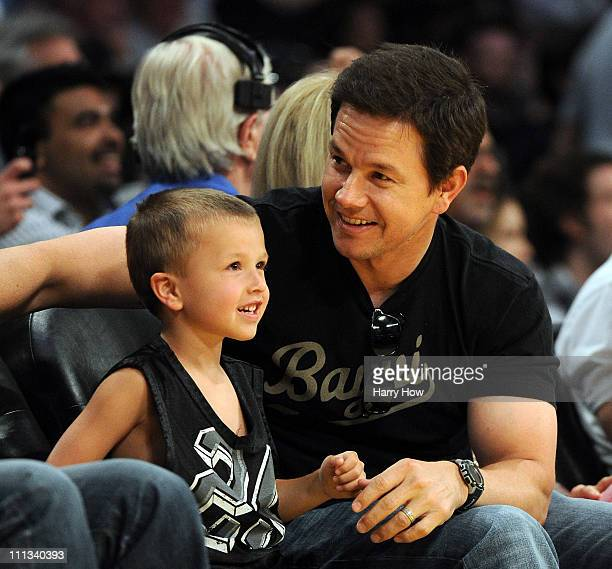 Actor Mark Walberg and his son Michael Walberg smile courtside during the game against the Dallas Mavericks and the Los Angeles Lakers at Staples...