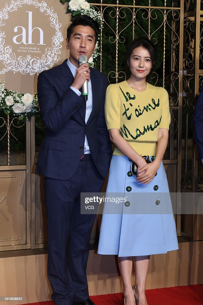 Actor <a gi-track='captionPersonalityLinkClicked' href=/galleries/search?phrase=Mark+Zhao&family=editorial&specificpeople=969876 ng-click='$event.stopPropagation()'>Mark Zhao</a> and his wife actress Gao Yuanyuan pose on the red carpet during the wedding ceremony of actor Huang Xiaoming and actress Angelababy at Shanghai Exhibition Center on October 8, 2015 in Shanghai, China.