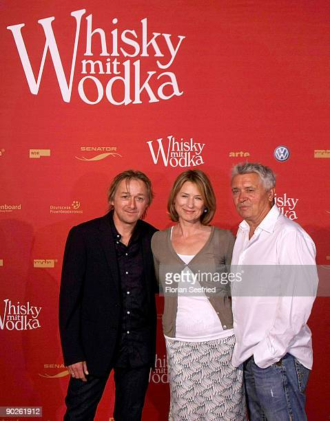 Actor Markus Hering actress Corinna Harfouch and actor Henry Huebchen attend the premiere of 'Whisky mit Wodka' at cinema International on September...