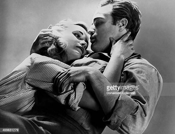 Actor Marlon Brando and Eva Marie Saint pose for a portrait on the set of the movie 'On the Waterfront' which came out in 1954