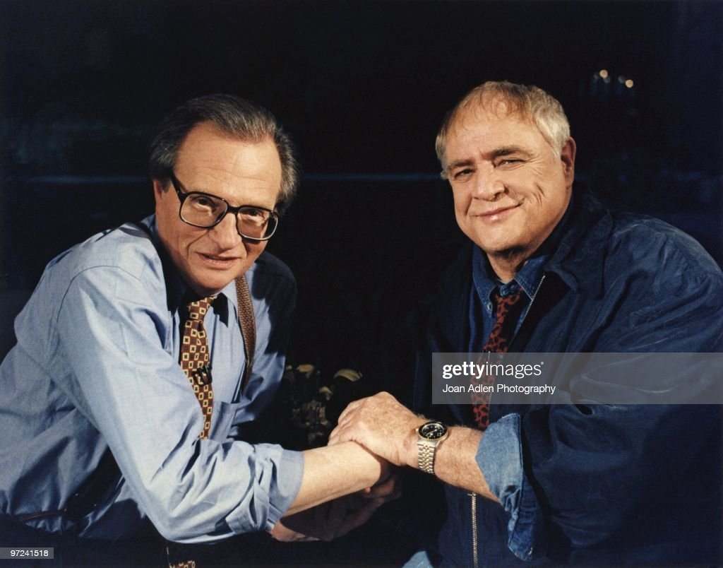 Actor <a gi-track='captionPersonalityLinkClicked' href=/galleries/search?phrase=Marlon+Brando&family=editorial&specificpeople=85897 ng-click='$event.stopPropagation()'>Marlon Brando</a> plants one on talk show host <a gi-track='captionPersonalityLinkClicked' href=/galleries/search?phrase=Larry+King&family=editorial&specificpeople=202014 ng-click='$event.stopPropagation()'>Larry King</a> during the taping of 'The <a gi-track='captionPersonalityLinkClicked' href=/galleries/search?phrase=Larry+King&family=editorial&specificpeople=202014 ng-click='$event.stopPropagation()'>Larry King</a> Show' taped at Brando's house in Coldwater Canyon on October 7, 1994, in Los Angeles, California.