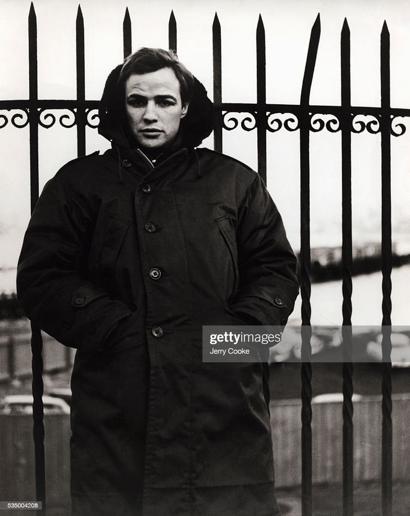 Actor Marlon Brando wears a heavy overcoat in Fort Lee, New Jersey, during the filming of his upcoming film, On the Waterfront.