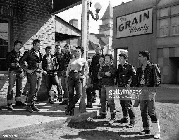 Actor Marlon Brando with Yvonne Doughty and his gang in a scene from the movie 'The Wild One' which came out in 1953