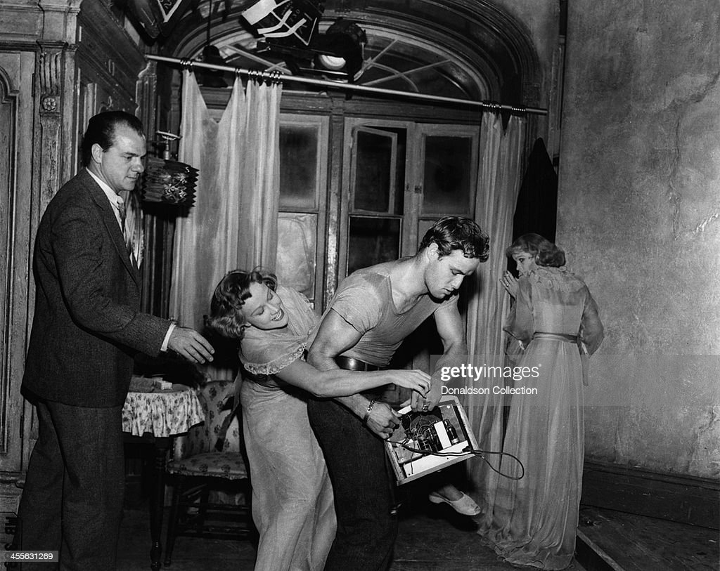 Actor Marlon Brando wrestles with Kim Hunter while Karl Malden and Vivien Leigh watch, on the set of the movie 'A Streetcar Named Desire' which came out in 1951.