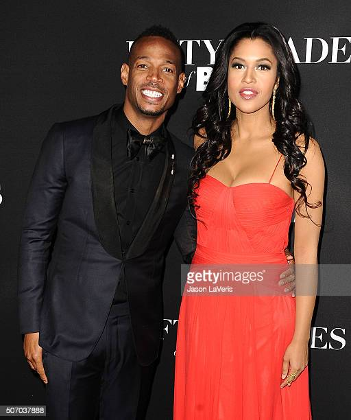 Actor Marlon Wayans and actress Kali Hawk attend the premiere of 'Fifty Shades of Black' at Regal Cinemas LA Live on January 26 2016 in Los Angeles...