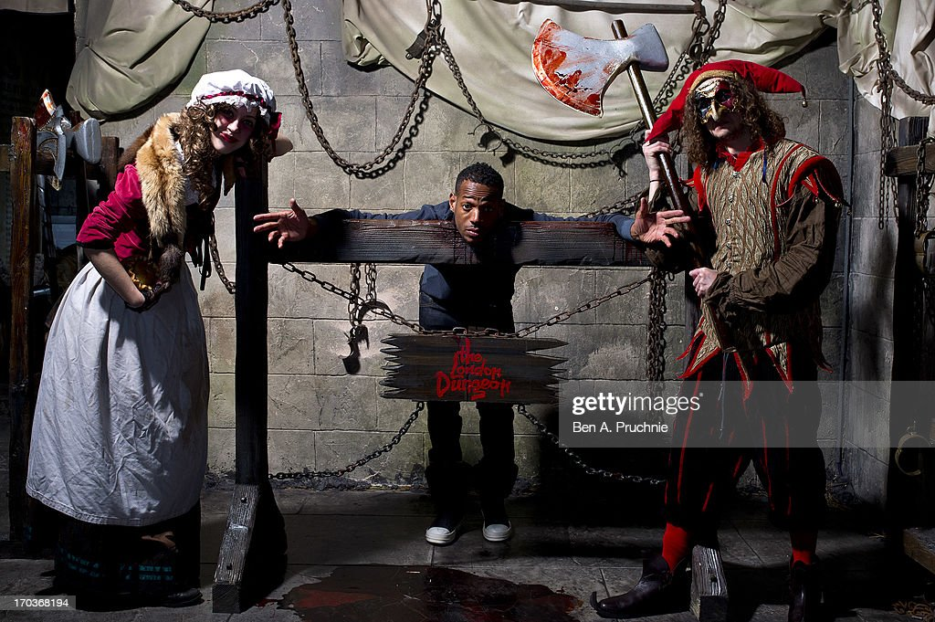 Actor <a gi-track='captionPersonalityLinkClicked' href=/galleries/search?phrase=Marlon+Wayans&family=editorial&specificpeople=203226 ng-click='$event.stopPropagation()'>Marlon Wayans</a> poses with performers ahead of the release of his new film 'A Haunted House' at London Dungeon on June 12, 2013 in London, England.