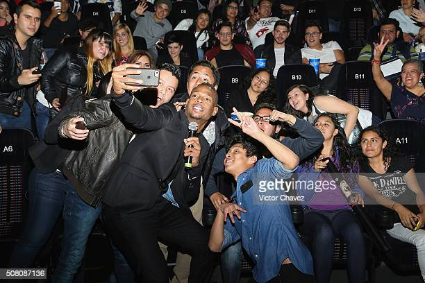 Actor Marlon Wayans takes a selfie with fans during the '50 Shades Of Black' Mexico City premiere at Cinepolis Diana on February 2 2016 in Mexico...
