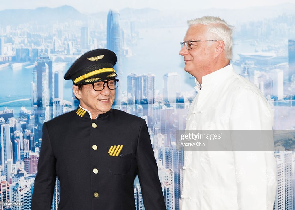 Actor & martial artist Jackie Chan and President and CEO of Vancouver Airport Authority Craig Richmond poses for a picture during the celebration of Hong Kong Airlines' inaugural flight to Vancouver, BC at Vancouver International Airport on June 30, 2017 in Vancouver, Canada.