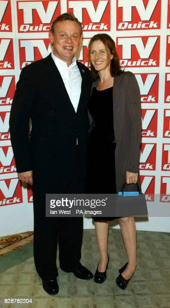 Actor Martin Clunes and his wife Philippa Braithwaite arrive for the TV Quick awards at the Dorchester Hotel in London