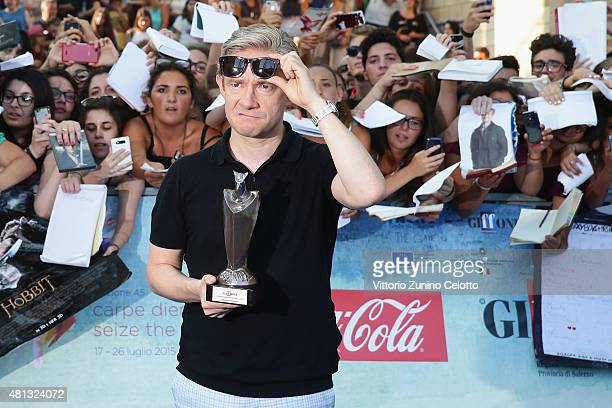 Actor Martin Freeman poses with the Giffoni Experience Award during the Giffoni Film Festival 2015 blue carpet on July 19 2015 in Giffoni Valle Piana...