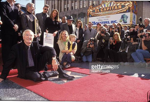 Actor Martin Landau left poses for photographers on his star on the Hollywood Walk of Fame Landau was honored with the 2187th star on the world...