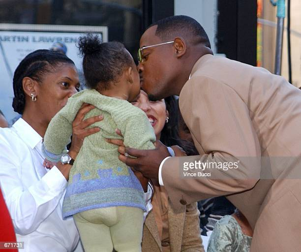Actor Martin Lawrence kisses his daughter Jasmine after a hand and footprint ceremony honoring him November 19 2001 at the famous Grauman's Chinese...