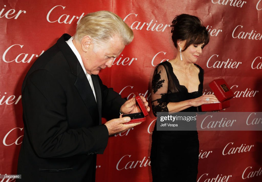 Actor <a gi-track='captionPersonalityLinkClicked' href=/galleries/search?phrase=Martin+Sheen&family=editorial&specificpeople=203224 ng-click='$event.stopPropagation()'>Martin Sheen</a> and Actress <a gi-track='captionPersonalityLinkClicked' href=/galleries/search?phrase=Sally+Field&family=editorial&specificpeople=206350 ng-click='$event.stopPropagation()'>Sally Field</a> pose with the Career Achievement Award during the 24th annual Palm Springs International Film Festival Awards Gala at the Palm Springs Convention Center on January 5, 2013 in Palm Springs, California.