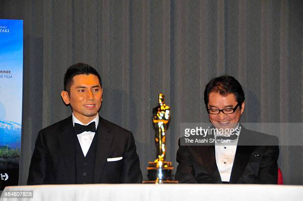 Actor Masahiro Motoki and director Yojiro Takita attend a press conference after the Departure winning the Academy Award for Best Foreign Language...