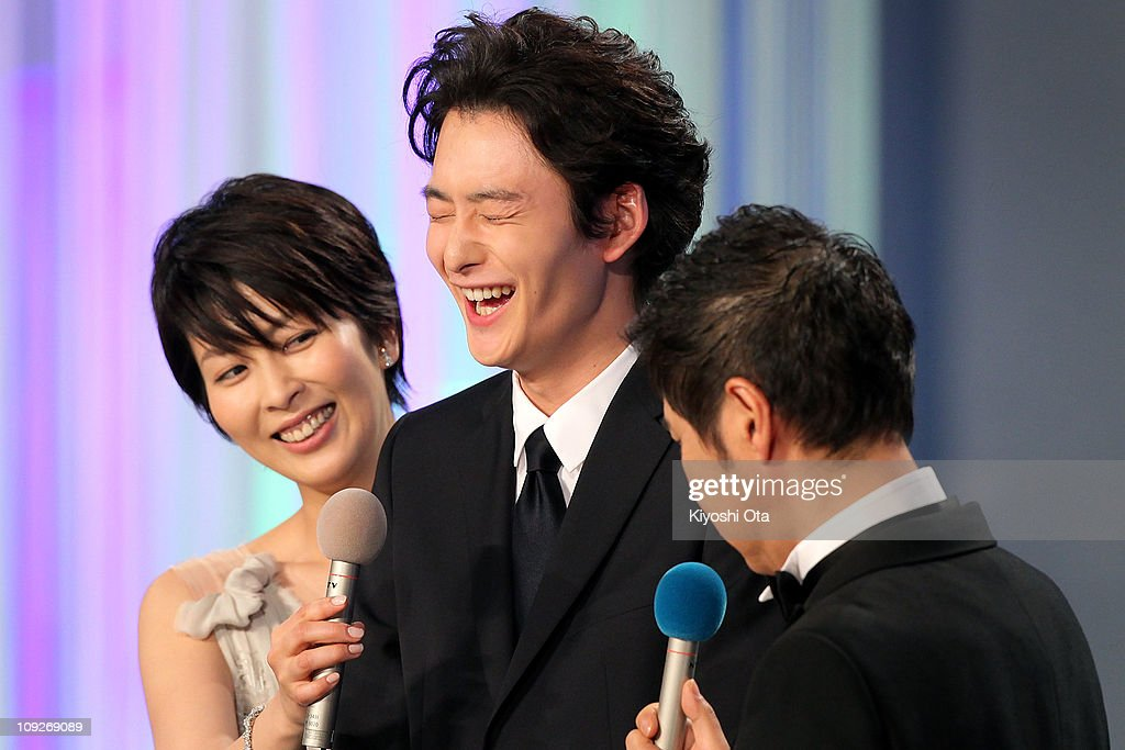 Actor Masaki Okada (C) appears on stage during the 34th Japan Academy Awards at Grand Prince Hotel New Takanawa on February 18, 2011 in Tokyo, Japan.