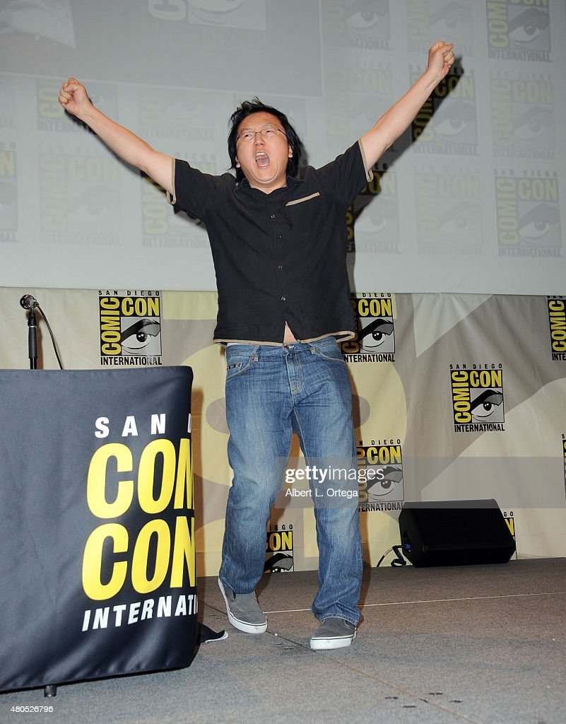 Actor Masi Oka waves to audience onstage at the 'Heroes Reborn' exclusive extended trailer and panel during Comic-Con International 2015 at the San Diego Convention Center on July 12, 2015 in San Diego, California.