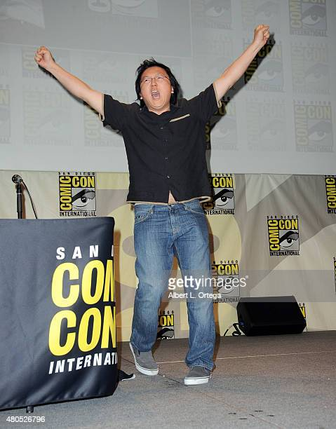 Actor Masi Oka waves to audience onstage at the 'Heroes Reborn' exclusive extended trailer and panel during ComicCon International 2015 at the San...