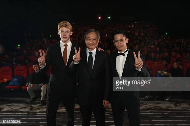 Actor Mason Lee his father director Ang Lee and British actor Joe Alwyn attend the premiere of Ang Lee's film 'Billy Lynn's Long Halftime Walk' on...