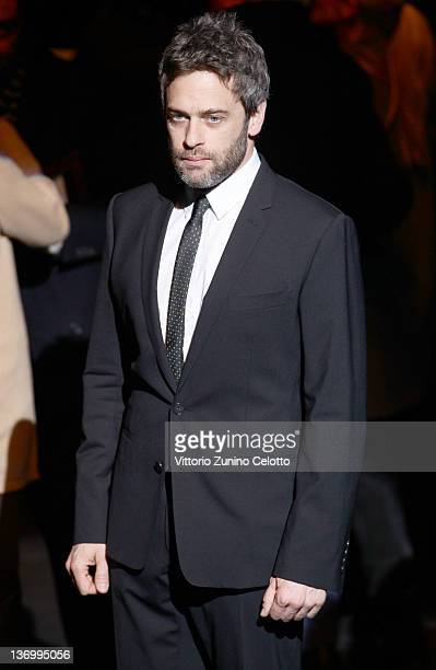 Actor Massimo Poggio poses on the runway prior the Dolce Gabbana fashion show as part of Milan Fashion Week Menswear Autumn/Winter 2012 on January 14...