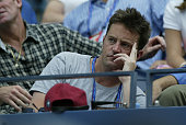 Actor Mathew Perry watches Jennifer Capriati compete against Emillie Loit during Day 6 of the US Open Tennis Tournament