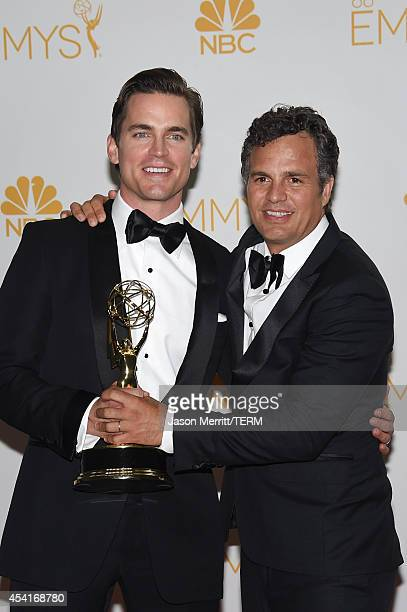 Actor Matt Bomer and Mark Ruffalo winners of the Outstanding Television Movie for 'The Normal Heart' pose in the press room during the 66th Annual...