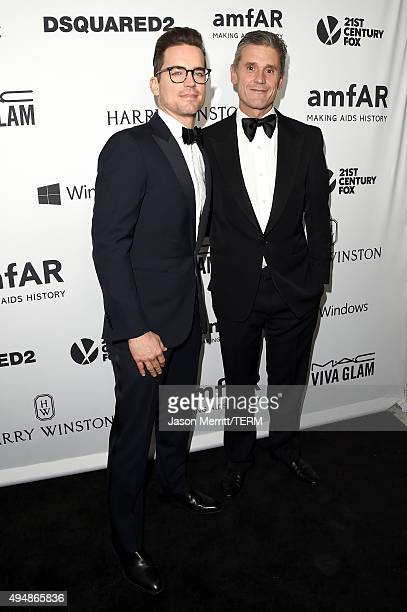 Actor Matt Bomer and Simon Halls attend amfAR's Inspiration Gala Los Angeles at Milk Studios on October 29 2015 in Hollywood California