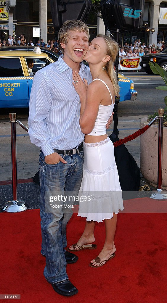 Actor Matt Czuchry receives a kiss from girlfriend/actress Kate Bosworth upon arrival at the world premiere of 'Eight Legged Freaks' at Grauman's...