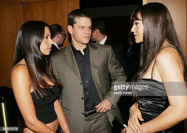 Actor Matt Damon and fiance Luciana Bozan talk with actress Monica Bellucci at the premiere of Dimension Film's 'The Brothers Grimm' at the Directors...