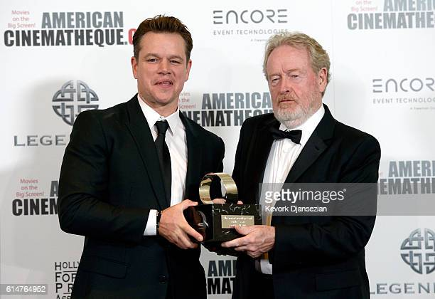 Actor Matt Damon and honoree Sir Ridley Scott pose with the American Cinematheque Award during the 30th Annual American Cinematheque Awards Gala at...