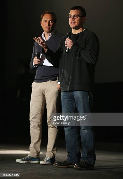 Actor Matt Damon and host Steven Gaetjen attend the trailer launch event for 'Elysium' at the CineStar on April 8 2013 in Berlin Germany