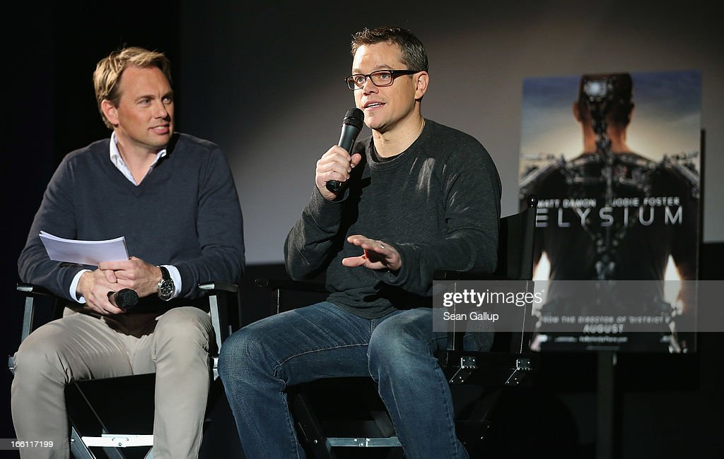 Actor <a gi-track='captionPersonalityLinkClicked' href=/galleries/search?phrase=Matt+Damon&family=editorial&specificpeople=202093 ng-click='$event.stopPropagation()'>Matt Damon</a> (R) and host <a gi-track='captionPersonalityLinkClicked' href=/galleries/search?phrase=Steven+Gaetjen&family=editorial&specificpeople=5284996 ng-click='$event.stopPropagation()'>Steven Gaetjen</a> attend the trailer launch event for 'Elysium' at the CineStar on April 8, 2013 in Berlin, Germany.
