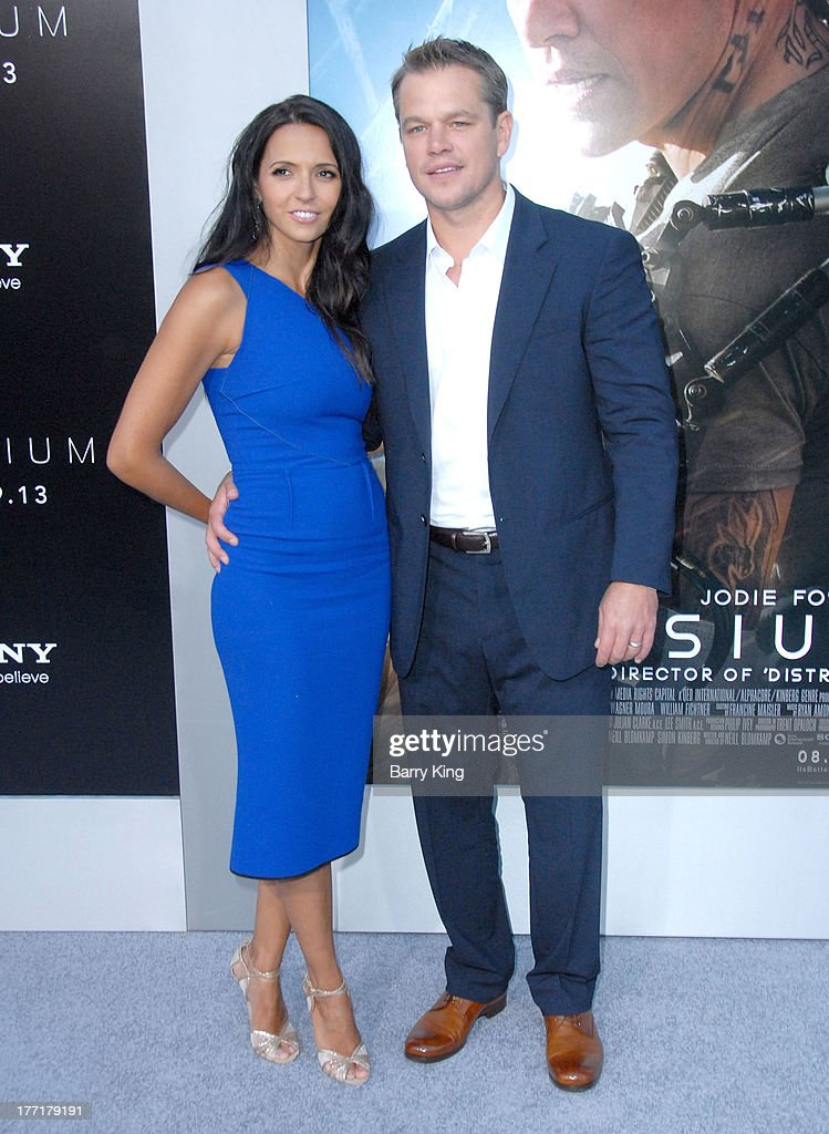 Actor Matt Damon (R) and wife Luciana Barroso arrive at the Los Angeles Premiere of 'Elysium' on August 7, 2013 at Regency Village Theatre in Westwood, California.