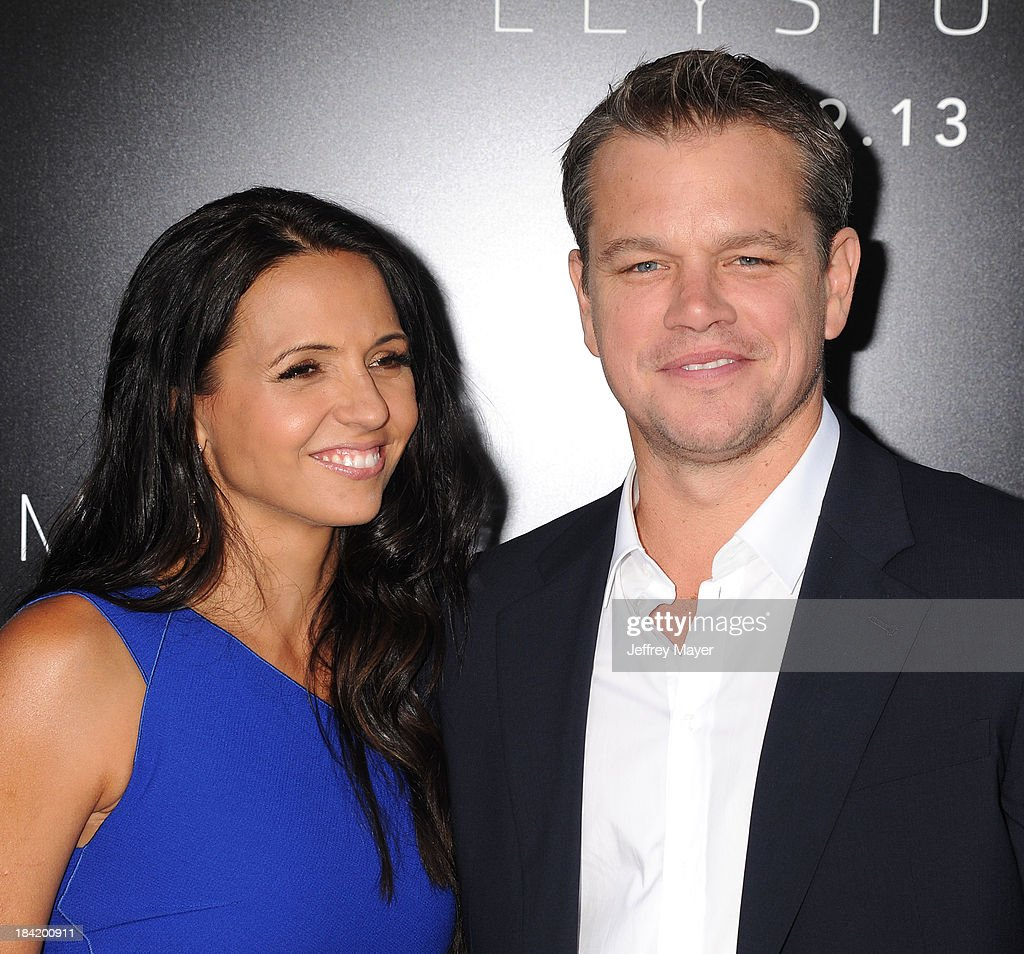 Actor <a gi-track='captionPersonalityLinkClicked' href=/galleries/search?phrase=Matt+Damon&family=editorial&specificpeople=202093 ng-click='$event.stopPropagation()'>Matt Damon</a> (R) and wife <a gi-track='captionPersonalityLinkClicked' href=/galleries/search?phrase=Luciana+Barroso&family=editorial&specificpeople=218169 ng-click='$event.stopPropagation()'>Luciana Barroso</a> arrive at the Los Angeles premiere of 'Elysium' at Regency Village Theatre on August 7, 2013 in Westwood, California.