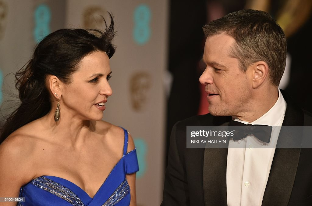 US actor Matt Damon (R) and wife Luciana Barroso pose on arrival for the BAFTA British Academy Film Awards at the Royal Opera House in London on February 14, 2016. N