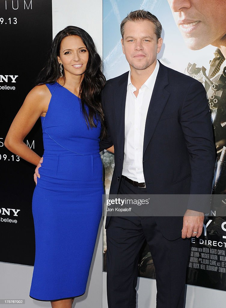 Actor Matt Damon and wife Luciana Barroso arrive at the Los Angeles Premiere 'Elysium' at Regency Village Theatre on August 7, 2013 in Westwood, California.