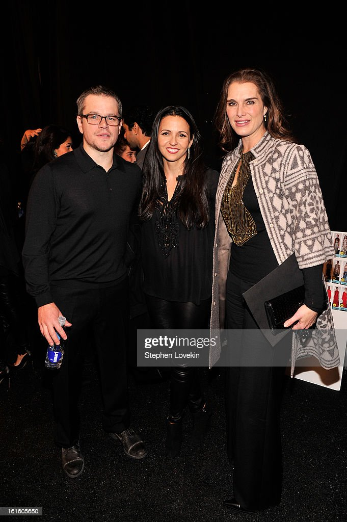Actor <a gi-track='captionPersonalityLinkClicked' href=/galleries/search?phrase=Matt+Damon&family=editorial&specificpeople=202093 ng-click='$event.stopPropagation()'>Matt Damon</a>, Luciana Barroso and actress <a gi-track='captionPersonalityLinkClicked' href=/galleries/search?phrase=Brooke+Shields&family=editorial&specificpeople=202197 ng-click='$event.stopPropagation()'>Brooke Shields</a> pose backstage at the Naeem Khan Fall 2013 fashion show during Mercedes-Benz Fashion Week at The Theatre at Lincoln Center on February 12, 2013 in New York City.