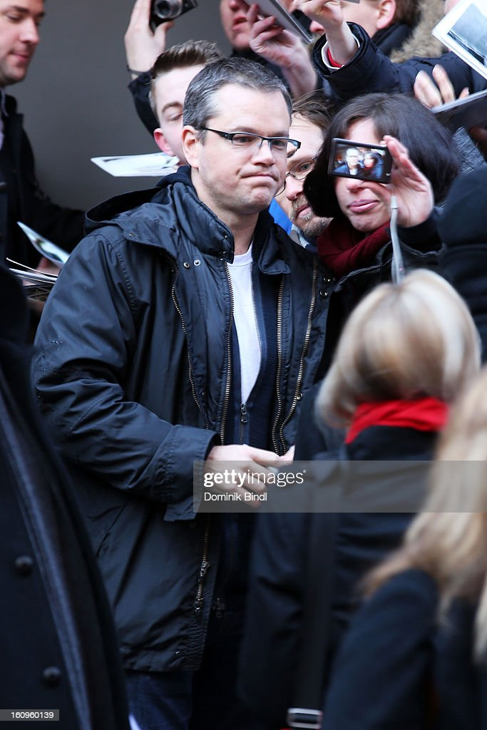 Actor <a gi-track='captionPersonalityLinkClicked' href=/galleries/search?phrase=Matt+Damon&family=editorial&specificpeople=202093 ng-click='$event.stopPropagation()'>Matt Damon</a> poses for pictures as he leaves the 'Promised Land' Press Conference during the 63rd Berlinale International Film Festival at the Grand Hyatt Hotel on February 8, 2013 in Berlin, Germany.