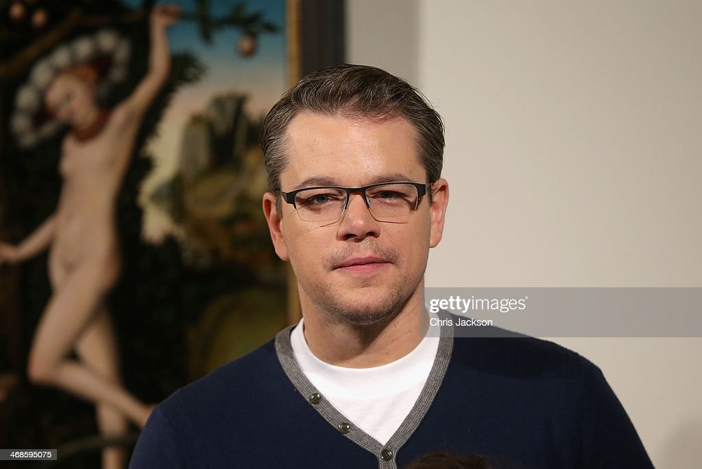 Actor Matt Damon poses in front of the painting 'Cupid Complaining to Venus' by Lucas Cranach the Elder as he attends a photocall for 'The Monuments Men' at The National Gallery on February 11, 2014 in London, England. The painting was once part of Adolf Hitler's private collection.