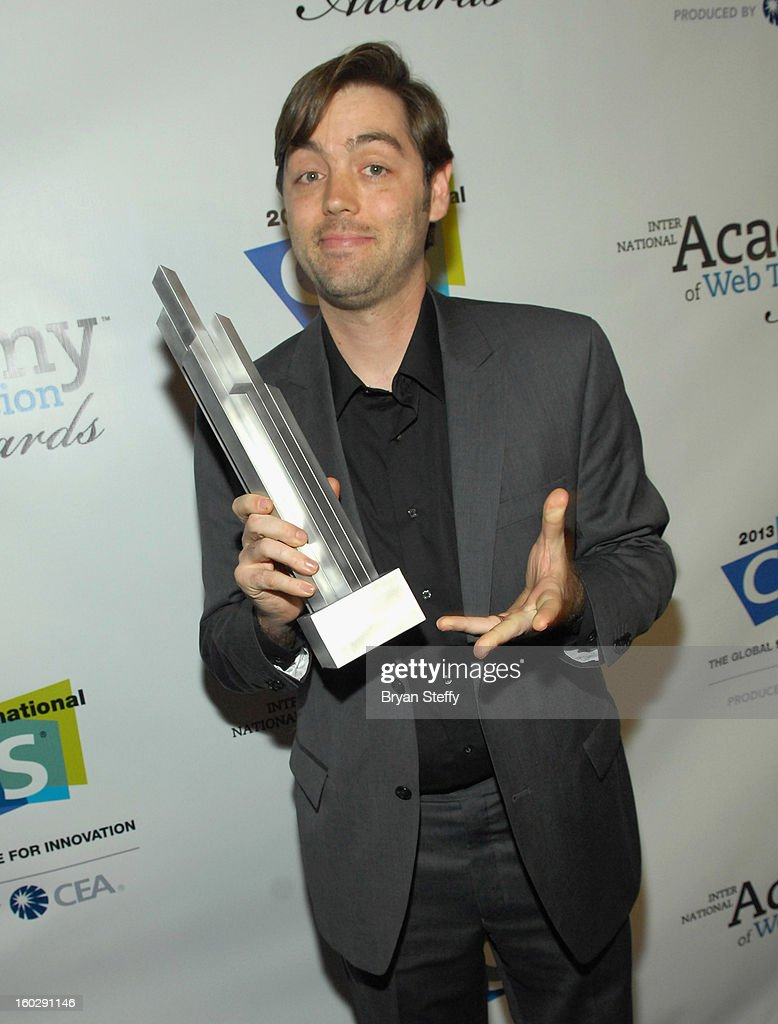 Actor Matt Enlow poses with the IAWTV award at the IAWTV Awards at the CES 2013 Show at the Palazzo Theater at the Palazzo Resort Hotel/Casino on January 8, 2013 in Las Vegas, Nevada.