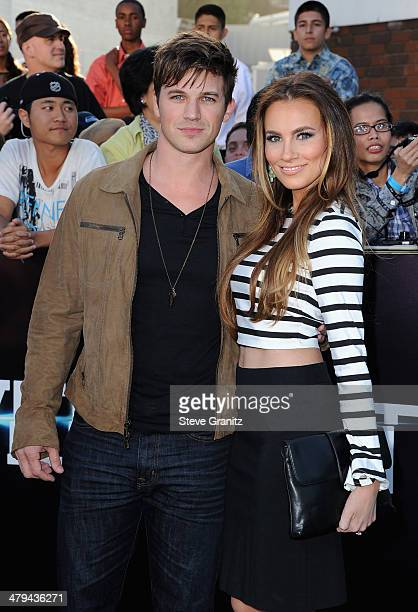 Actor Matt Lanter and Angela Stacy arrive at the premiere of Summit Entertainment's 'Divergent' at the Regency Bruin Theatre on March 18 2014 in Los...