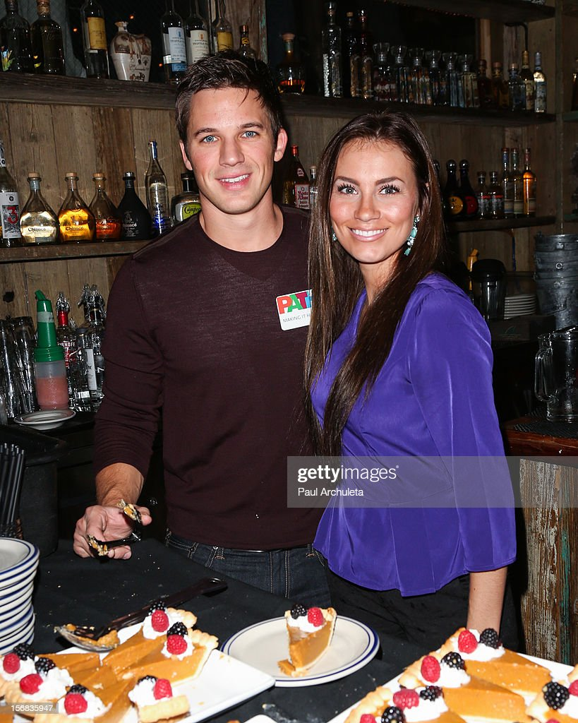 Actor <a gi-track='captionPersonalityLinkClicked' href=/galleries/search?phrase=Matt+Lanter&family=editorial&specificpeople=585848 ng-click='$event.stopPropagation()'>Matt Lanter</a> (L) and hid Girlfriend Angela Stacy (R) attend PATH's 4th Annual Thanksgiving Meal at Pink Taco on November 22, 2012 in Los Angeles, California.