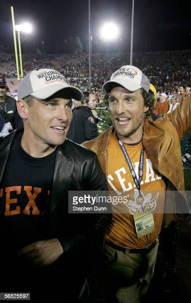 Actor Matthew McConaughey and cyclist Lance Armstrong celebrate after the Texas Longhorns defeated the USC Trojans 4138 to win the BCS National...