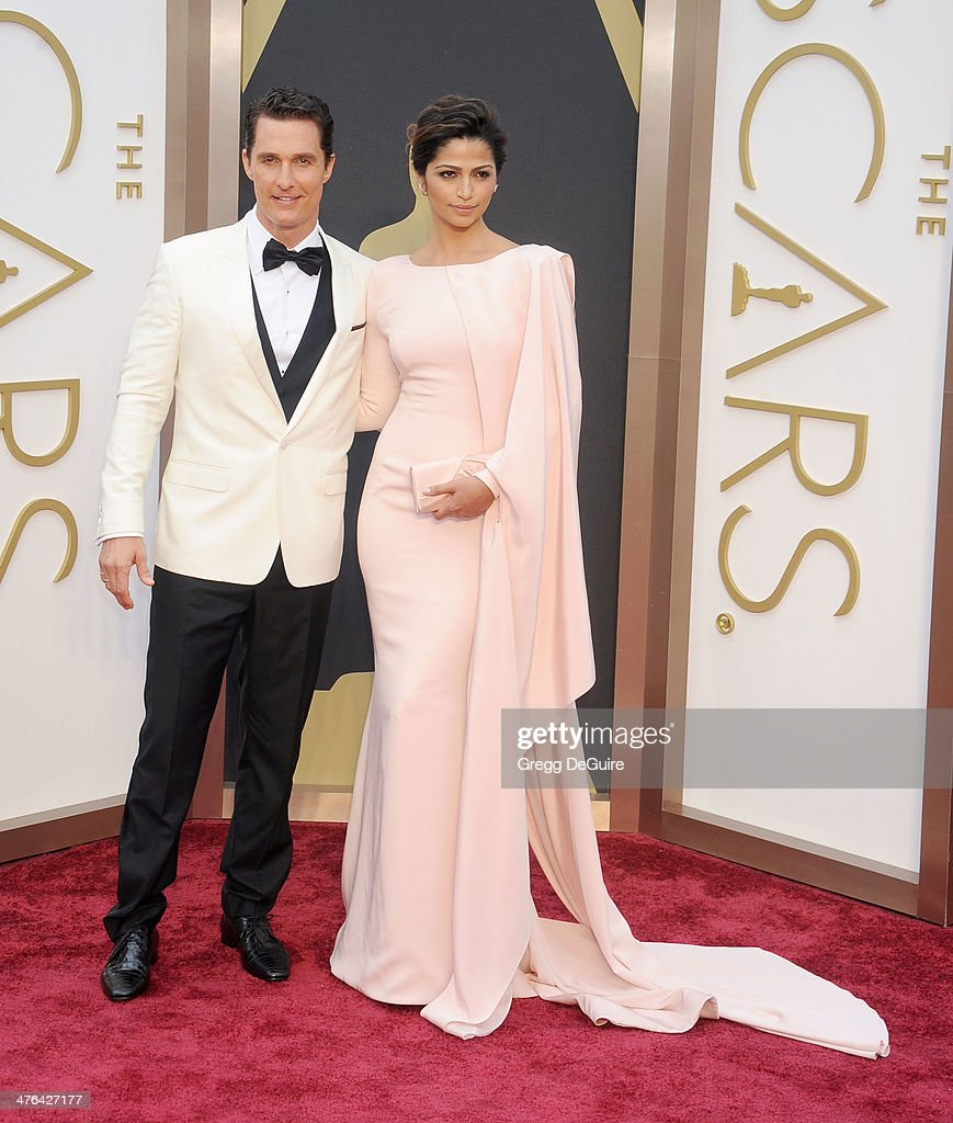 Actor Matthew McConaughey and model Camila Alves arrive at the 86th Annual Academy Awards at Hollywood & Highland Center on March 2, 2014 in Hollywood, California.
