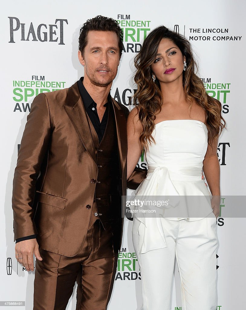 Actor Matthew McConaughey (L) and model Camilla Alves attend the 2014 Film Independent Spirit Awards at Santa Monica Beach on March 1, 2014 in Santa Monica, California.