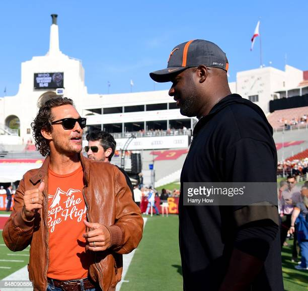 Actor Matthew McConaughey and quarterback Vince Young talk on the sidelines before the game between the Texas Longhorns and the USC Trojans at Los...
