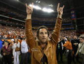 Actor Matthew McConaughey celebrates after the Texas Longhorns defeated the Ohio State Buckeyes in Tostitos Fiesta Bowl Game on January 5 2009 at...