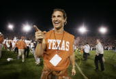 Actor Matthew McConaughey celebrates on the field after the Texas Longhorns defeated the Michigan Wolverines in the 91st Rose Bowl Game at the Rose...
