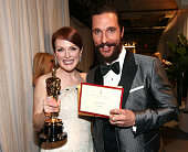 Actor Matthew McConaughey escorts winner Julianne Moore backstage as she holds her statuette for Actress in a Leading Role during the 87th Annual...